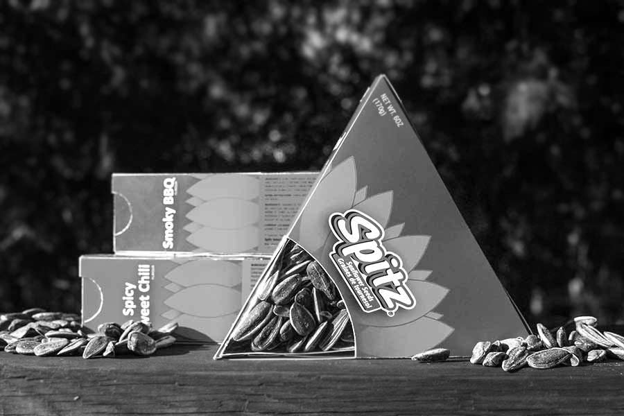 A preview of the Spitz packaging redesign, created as a more environmentally friendly package while still maintaining Spitz brand image.